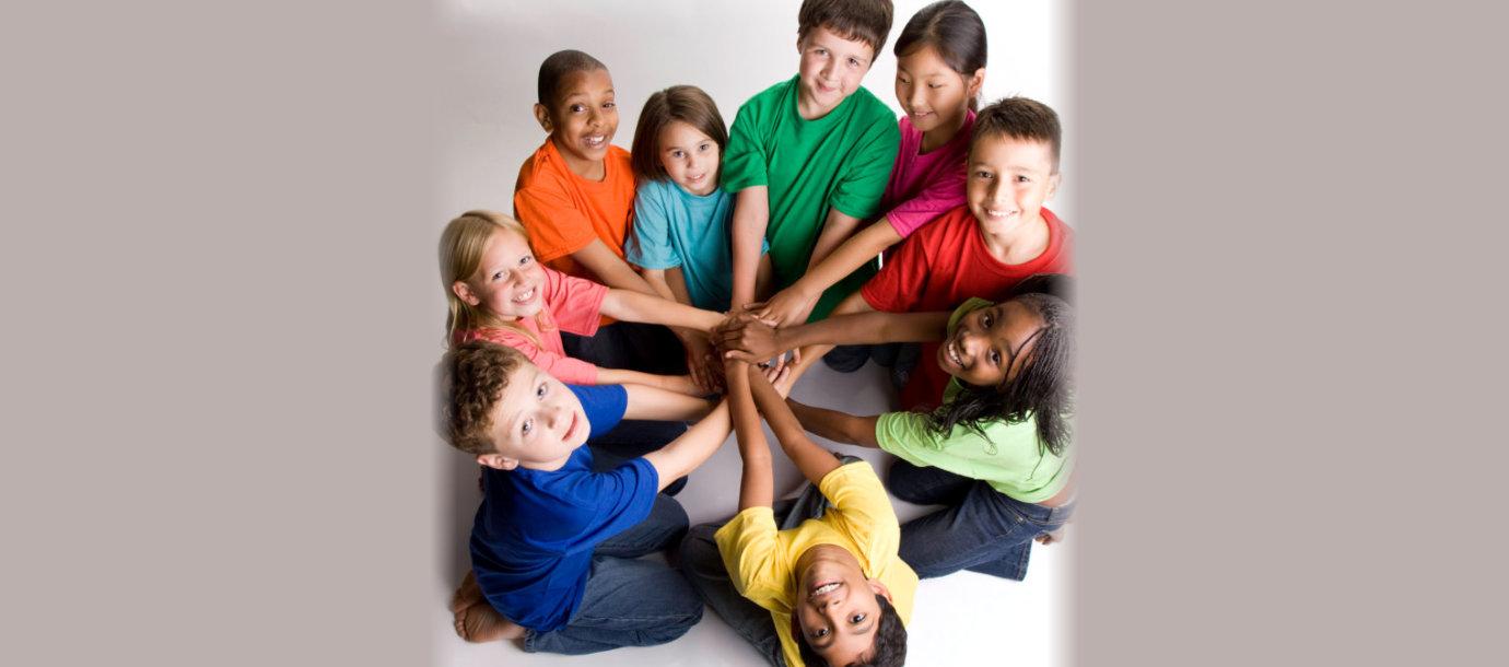 children putting their hands in the center